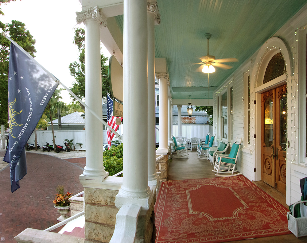 Front porch of the Curry Mansion. Opens in a photo gallery pop out.