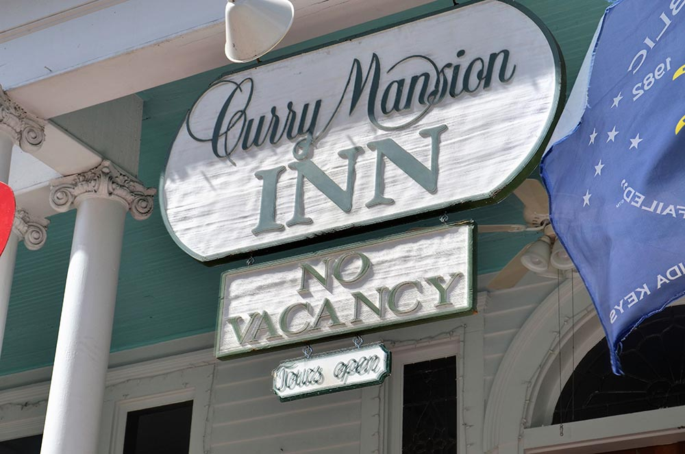 Curry Mansion Inn front sign. Opens in a photo gallery pop out.