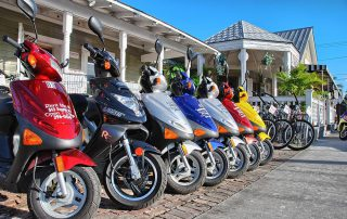 Scooters park in front of store in Key West