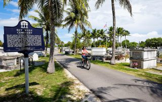 Person bicycling in the Key West cemetery